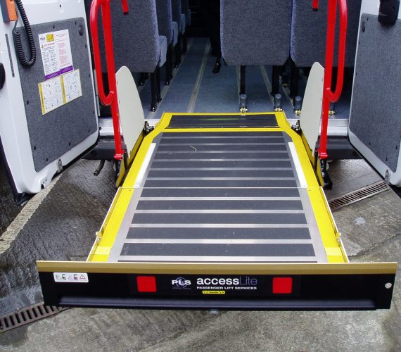 picture showing a tail lift into a vehicle. All our vehicle have accessibility features such as this.